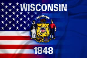 composite US and Wisconsin flags to illustrate article about Wisconsin Pandemic Relief Grants